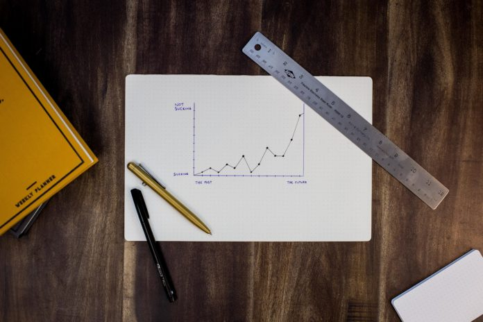 Graph, pens and a ruler on a table